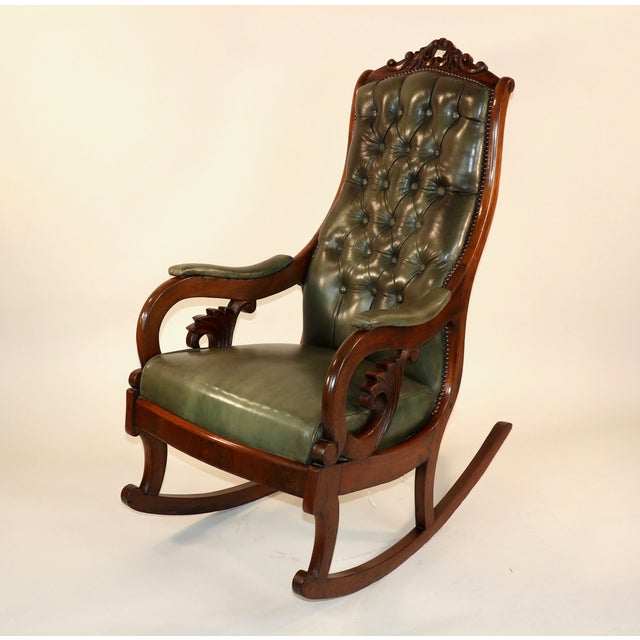 Circa 1835 English William IV Mahogany & Leather Rocking Chair. The chair has beautiful aged green leather button-back...