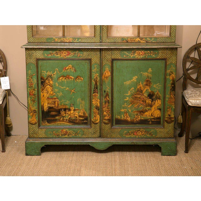 A beautiful George III 2 part bookcase Japanned in green and gilt. Upper section newly lined in suede. Paint probably later.