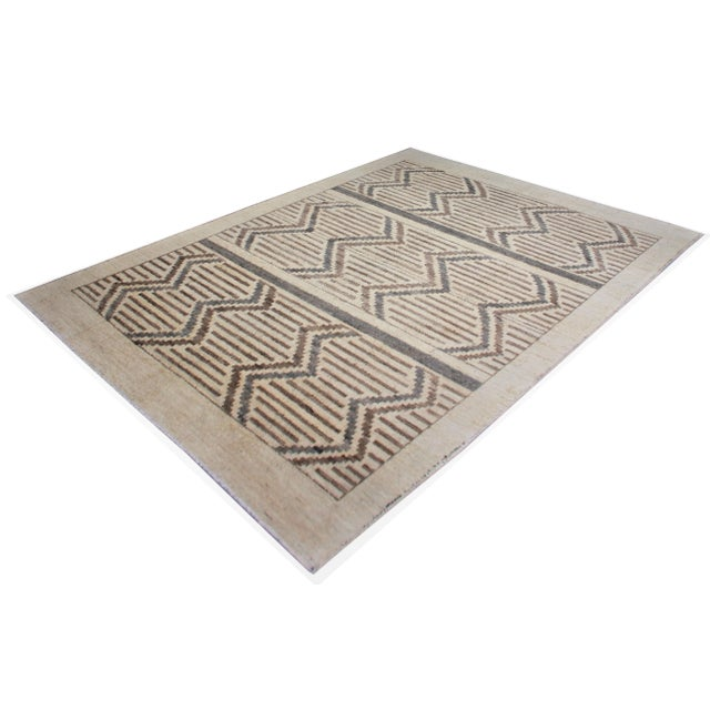 A beautiful handmade Navajo style rug. Geometric design woven in by Aara Rug hands. This rug is made of 75% bamboo silk...