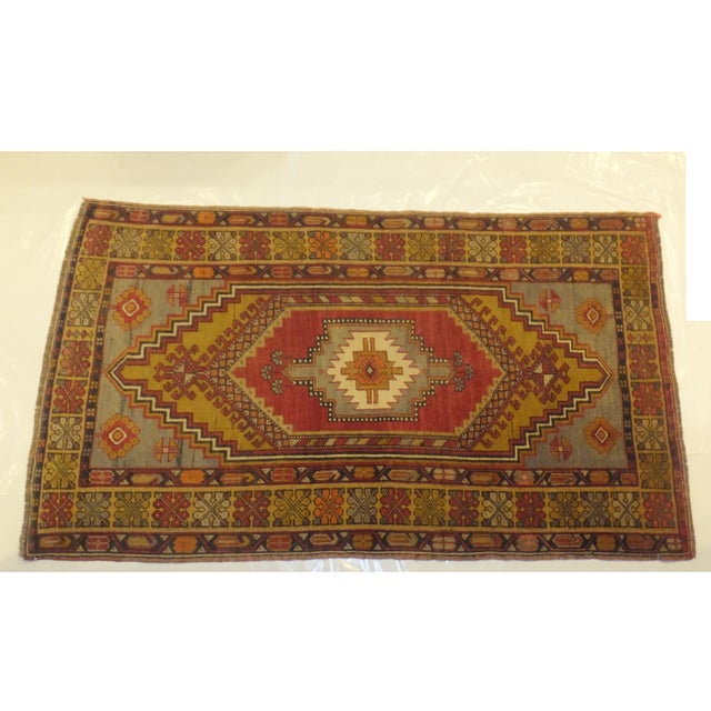 The rich, warm colors and intricate patterns of this Anatolian Turkish Oushak rug are sure to steal the show in any space....
