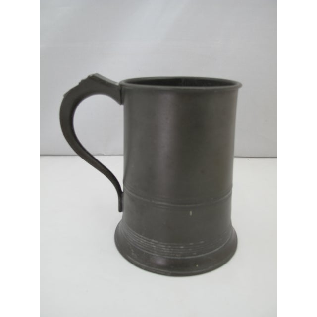 Victorian era one quart pewter tankard. Marked with four pseudo-marks and quart capacity stated. Also has with quantity...