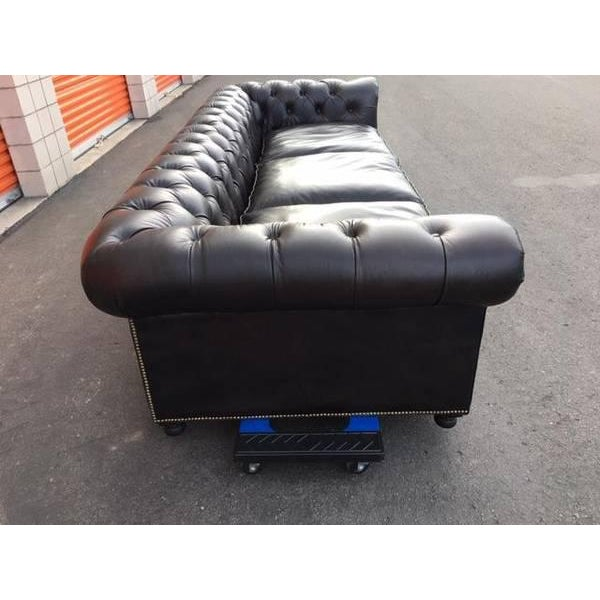 Timothy Oulton black leather Chesterfield sofa. It came from a weekend vacation house and is in impeccable condition. No...