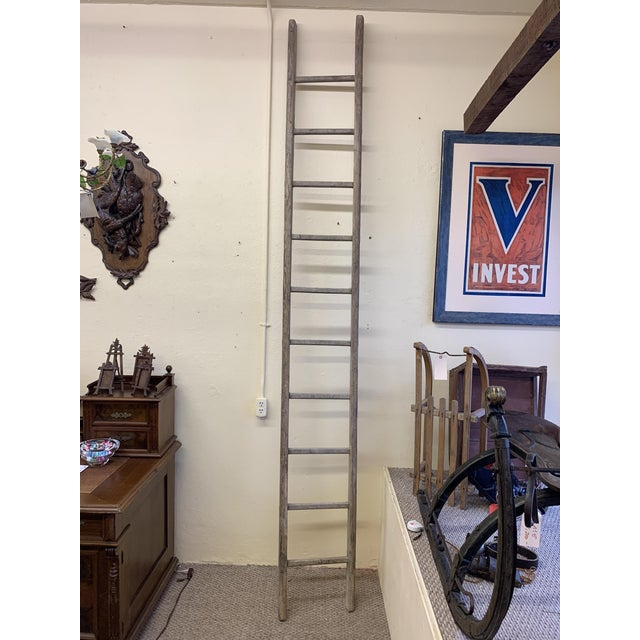 Tall Antique Wooden Ladder from Germany. The wood is pine. The ladder is tall enough that you could cut it in half to make...