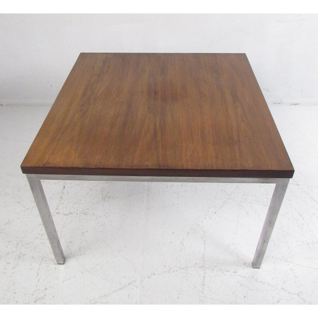 This stunning Milo Baughman style coffee table features a walnut top and a heavy chrome base. A simple, yet sleek design...