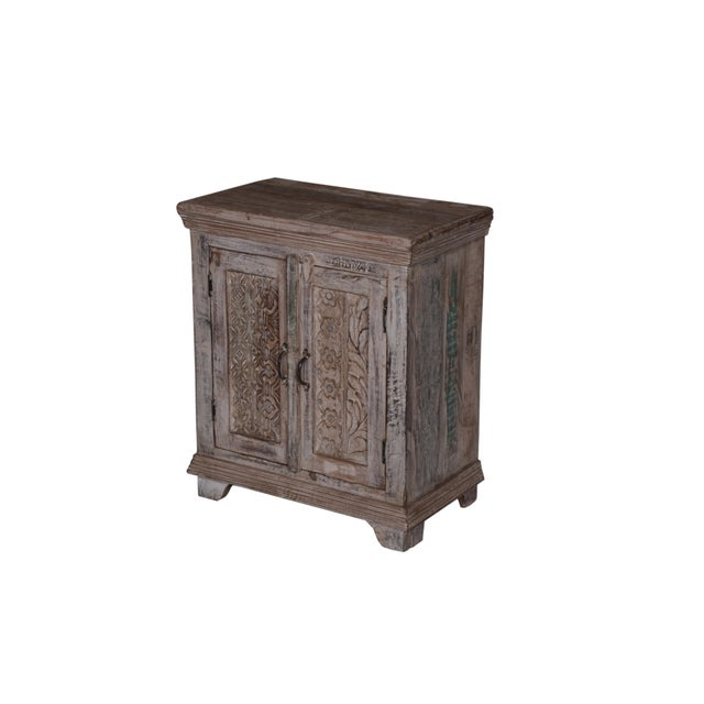 Keep your home clean and organize with the help of this beautiful storage two door cabinet. Crafted of recycled wood with...
