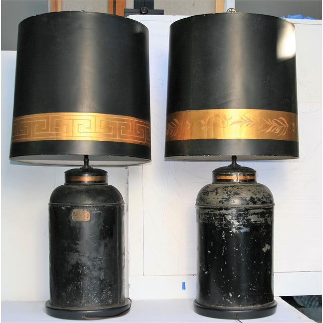 A pair of hand painted Antique Chinoiserie metal Tea Caddy Lamps with matching hand painted lamp shades. On the Caddy Lamp...