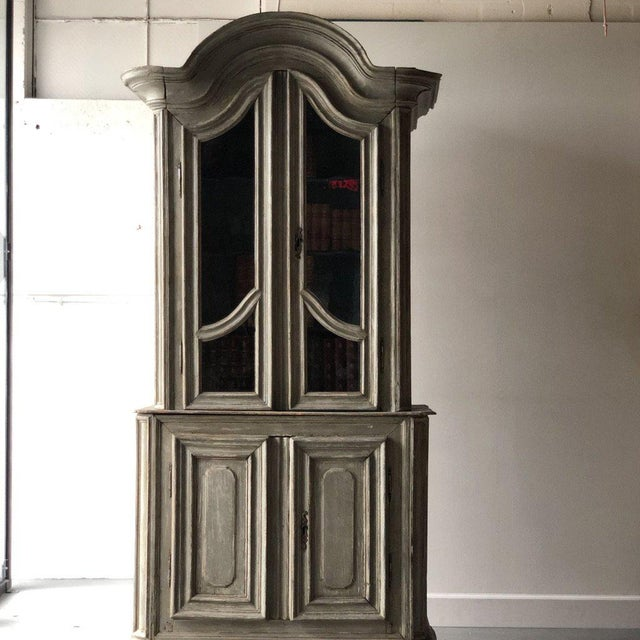 Early-19th-C. French bookcase, top has 2 glass doors that open to 4 shelves. Base has 2 wooden doors for more storage....