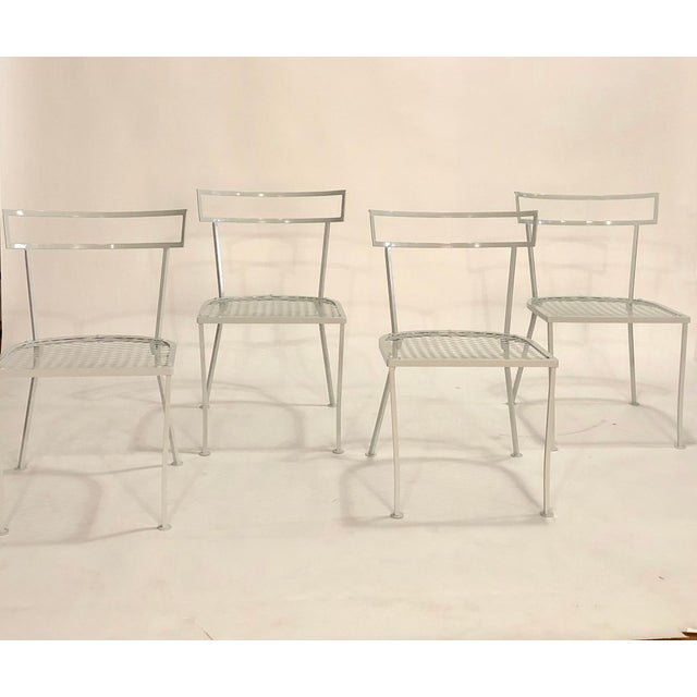 Set of 4 vintage Klismo patio dining chairs fully restored in a light gray rust-proof powdercoat.