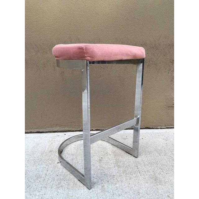 Pair of Design Institute of America flat bar chrome stools.
