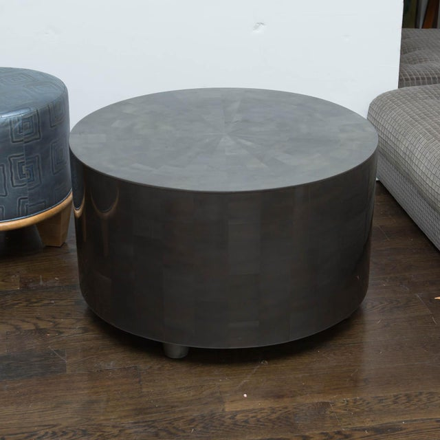 Modern drum table made of hand-cut resin veneers.