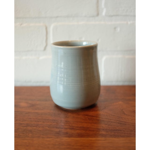 """Signed Handmade Studio Pottery Vessel in a soft glossy baby blue glaze. Signed """"MACKS"""" on the bottom. Date of production..."""