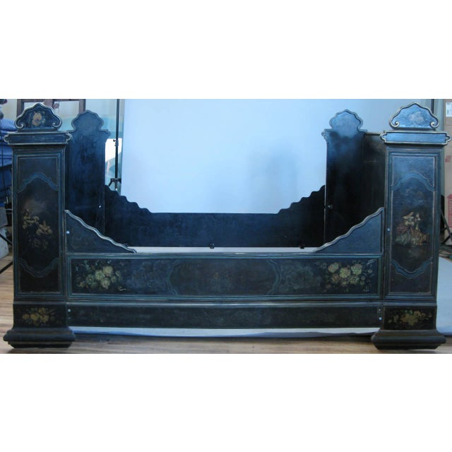 a romantic and bold antique Victorian cast iron bed with tall head and foot, and entirely hand painted with floral and...