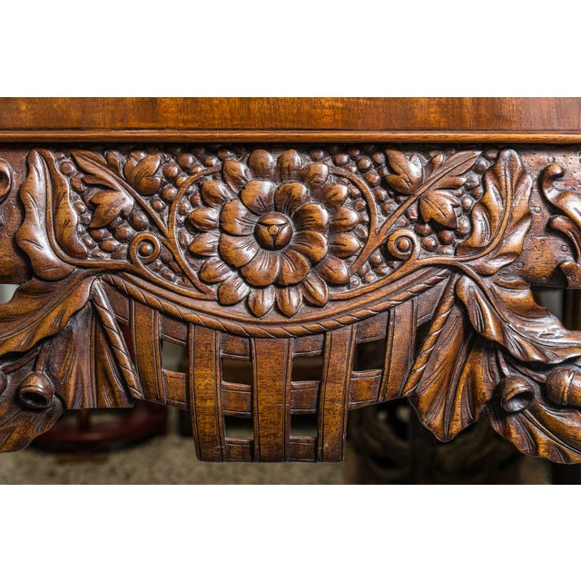 Irish Chippendale style center table. With oak leaf and acorn carved designs, and paw feet. Marble top