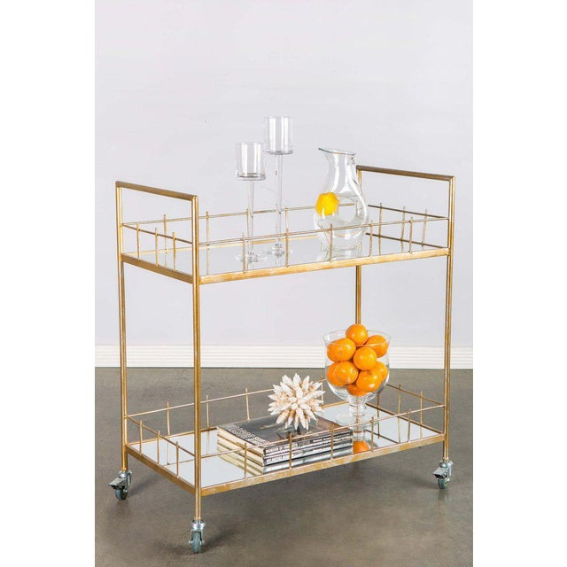 """New bar cart with mirrored glass and wheels Materials : Metal, glass Measurements: 32.5""""h x 34"""" w x 17""""d, 34 pounds"""