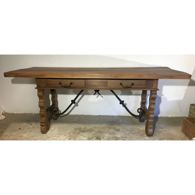 About This elegant, antique fruitwood desk was crafted in Spain, circa 1780. The rustic writing table has been stripped...