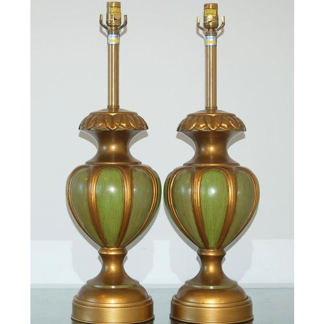 Another stylish pair of Italian lamps from Marbro - these in a brass toned ceramic body with inset panels of Green. They...