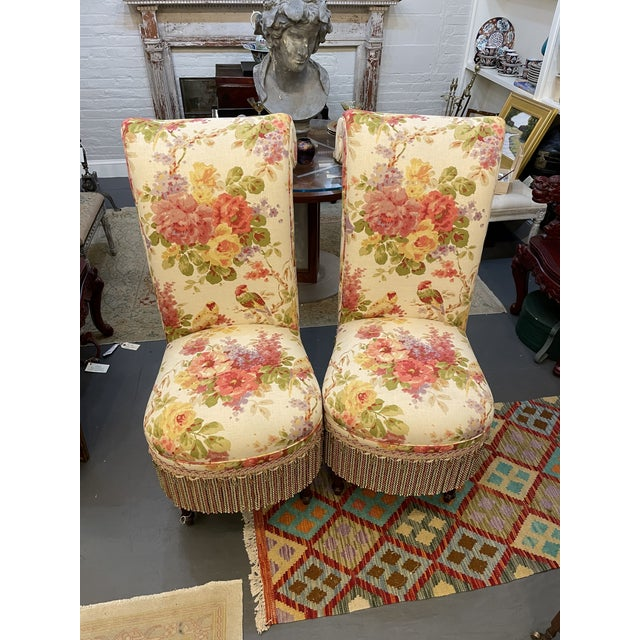 This set of parsons chairs is absolutely beautiful. The bright floral fabric paired with the decorative skirts makes for...