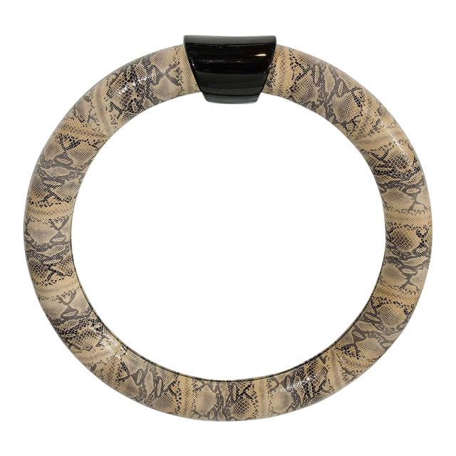 Mid-century modern round mirror wrapped in stunning embossed leather with snakeskin print. Faux python printed leather...