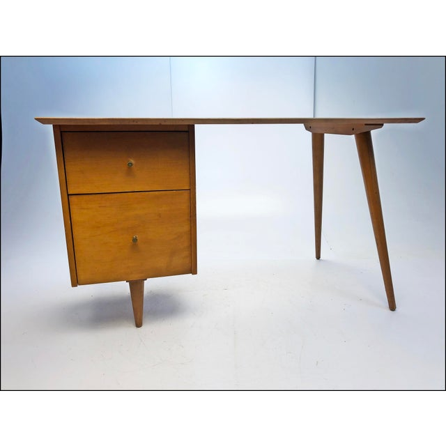VINTAGE MID CENTURY MODERN DESK & CHAIR. Wood has some light scratches and edges have wear from normal use. Piece is sold...