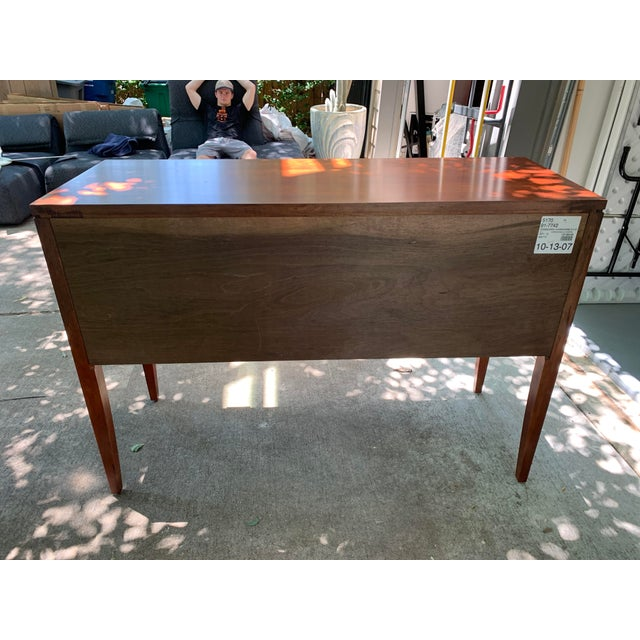 A statement piece for the dining room or front hall, this sideboard features three side hung and center guided drawers...