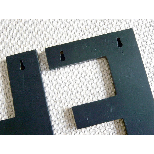 "Pair of wooden (ash?) letters, reproduction. H measures 11-1/8 x 8-1/8 x 3/8"" E measures 11-1/8 x 7 x 3/8"" Keyholes for..."