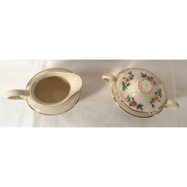 Beautiful dainty floral pattern on this creamer and sugar set. The top to the sugar bowl has two chips - see pictures....