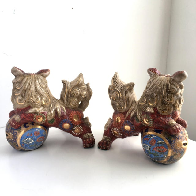 A fantastic pair of vintage Foo Dog statues thought to be from Andrea by Sadek. These are a lovely deep red color with...