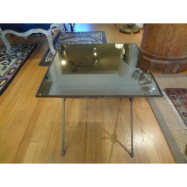 Charming square French Maison Jansen or Maison Bagues style brass/bronze gueridon. This French table with a mirrored top...