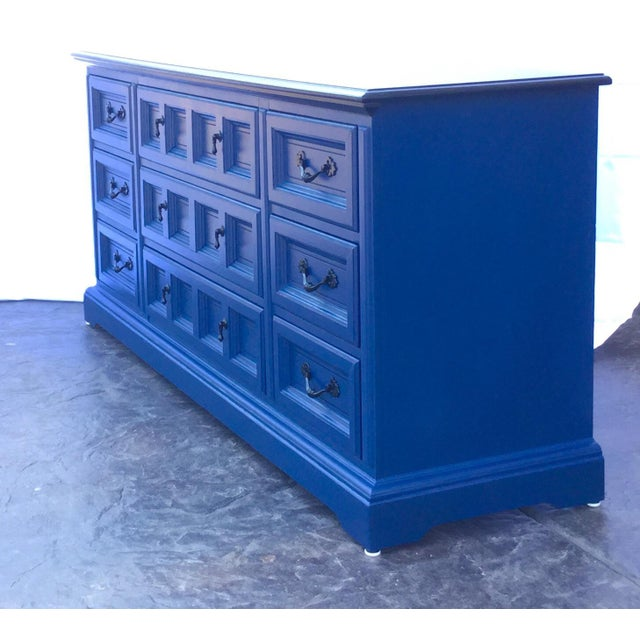Nine drawer Dixie dresser with lacquered black top, black hardware, and Napoleonic Blue body and drawers. Body has been...
