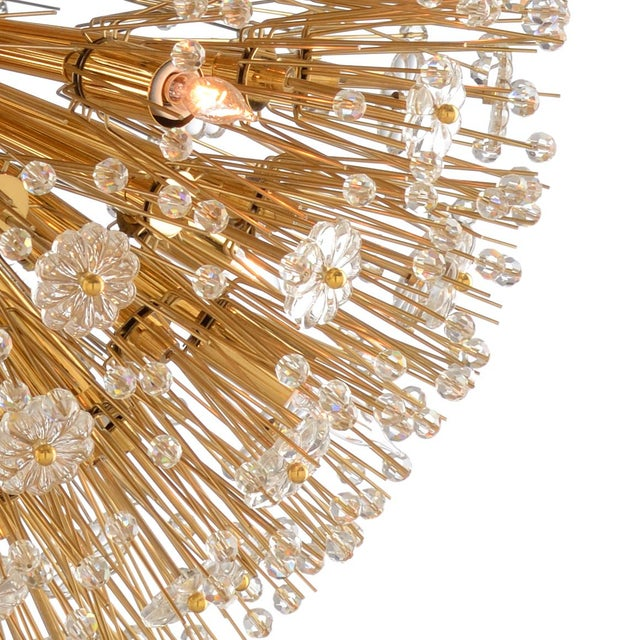 193's hollywood regency chandelier,sparkling crystal flowers & faceted beads burst from the center orb. polished brass...