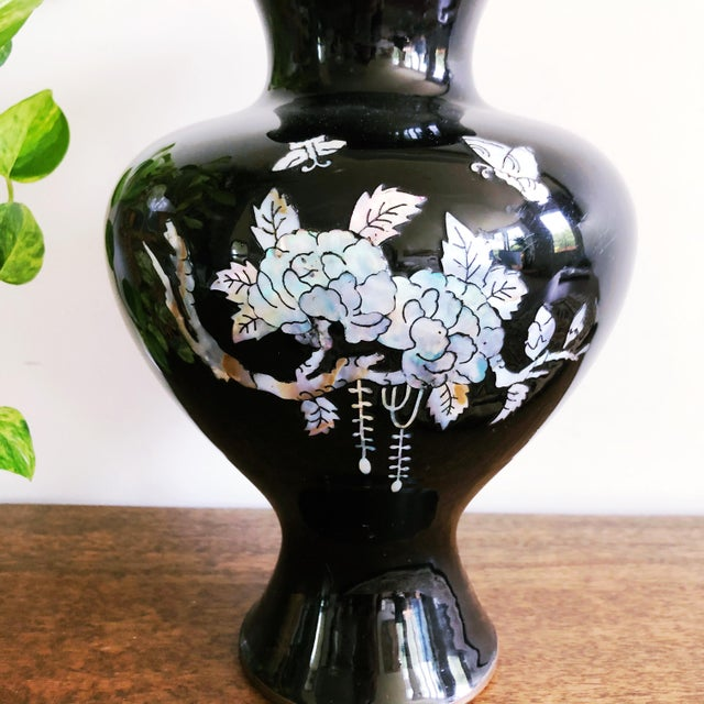 Vintage Japanese brass vase with black enamel exterior and mother of pearl inlay.