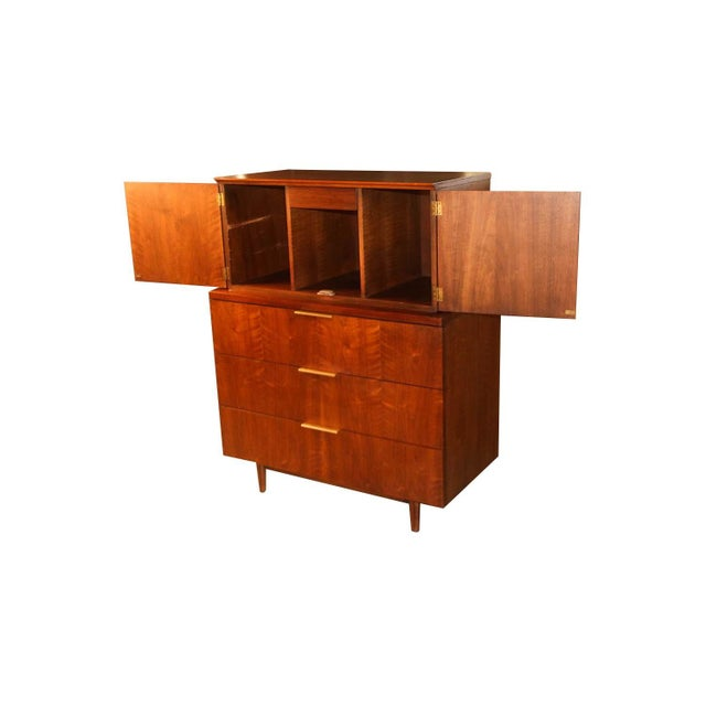 Absolutely stunning Mid-Century Modern Highboy dresser designed by John Stuart for Johnson Furniture Co. in the United...