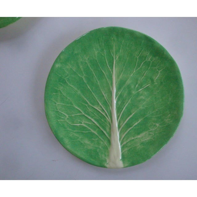 "Two rare and early handmade Dodie Thayer 10"" dinner plates in her renowned cabbage leaf lettuceware line. No flaws,..."