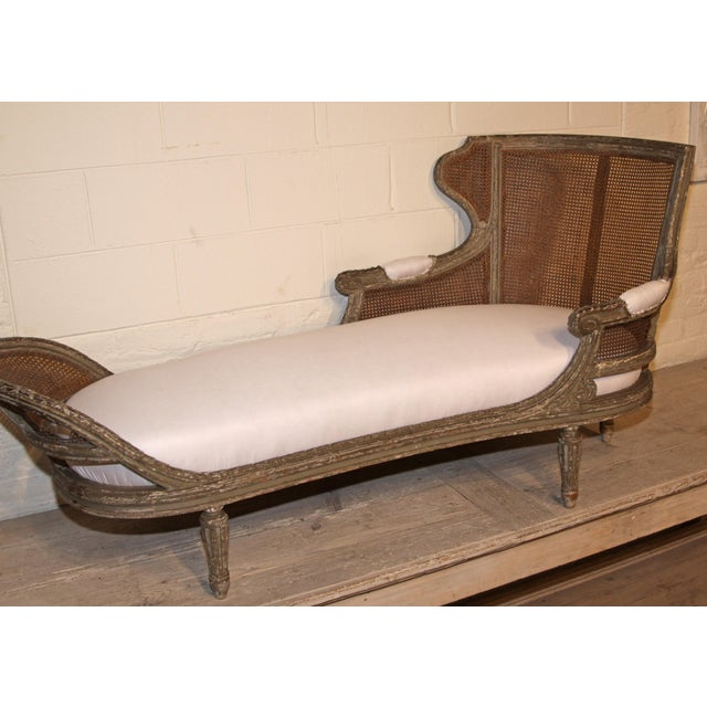 The most perfectly French chaise lounge, from 1850. We discovered this caned piece in the markets of Paris during our...