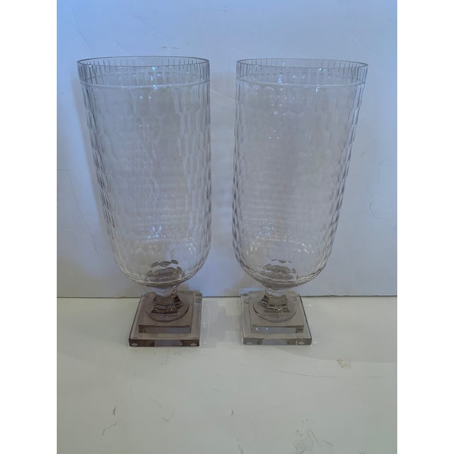 A large pretty pair of cut glass cylindrical hurricanes. Base is smoky; one is slightly darker than the other.