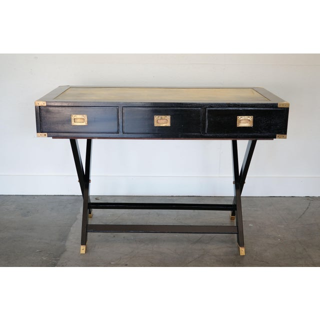 This is a unique console table that can also function as a desk. Beautifully finished in a lacquer with a leather top.