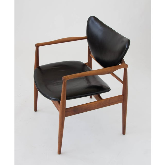 Armchair designed by Finn Juhl and produced by Baker Furniture, the Model 48 was designed in 1948 and features a solid...