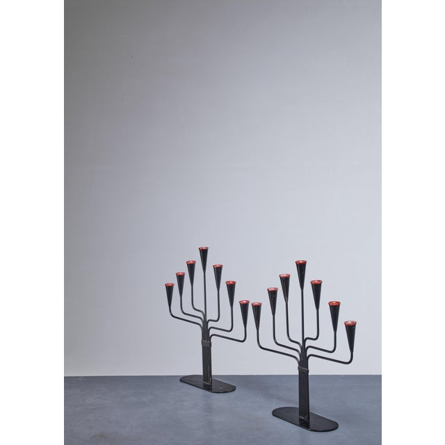 A pair of candelabras for seven candles each, designed by Gunnar Ander for Ystad, Sweden. They are made of black lacquered...