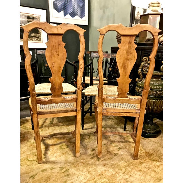 This is charming pair of country-form Swedish Baroque side chairs. Both chairs are in overall very good condition and...