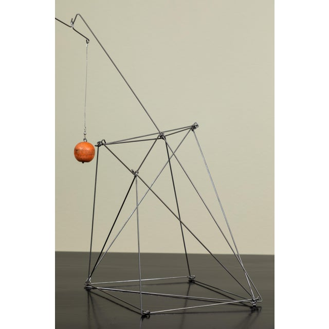 Table top balancing sculpture. Wire and wooden found objects. The Santa Barbara, Calif. artist, Dan Levin refers to the...