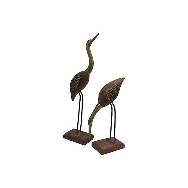 "Pair of midcentury modern hand-crafted brass & rose wood birds statues. Low bird measures 10"" H. Some of the brass..."