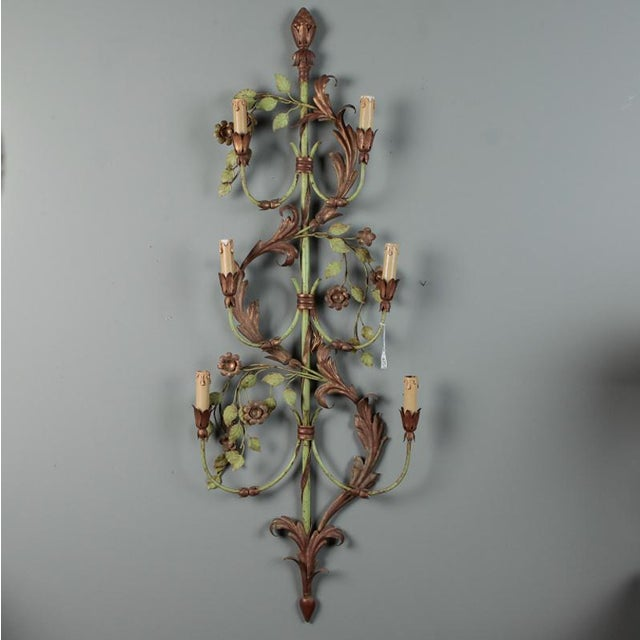 This pair of very tall circa 1920s French six light tole sconces have a design of acanthus leaves and flowering vines with...