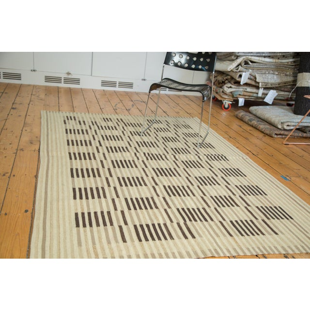 Simplistic and minimalist rug with symmetrical linear pattern and bold detail. Colors and shades include ivory, grey,...