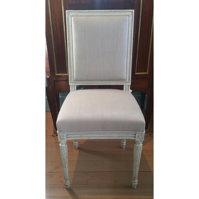 Set of 10 beautiful square back dining chairs.