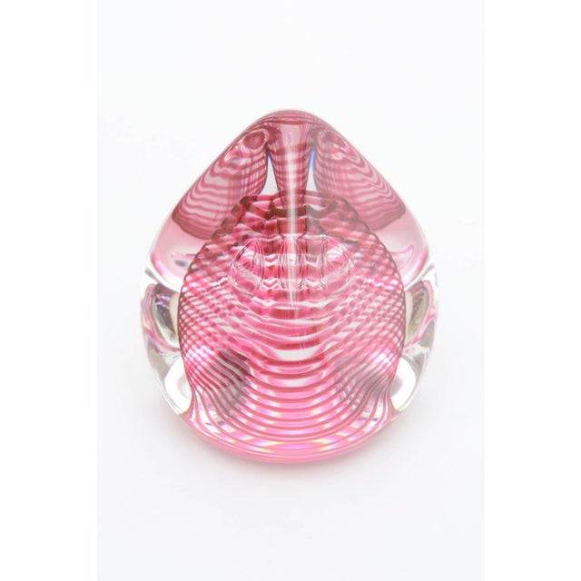 It looks like a teardrop or a kiss candy. Luscious bands of magenta pink swirl in spiral form incased in clear. There are...