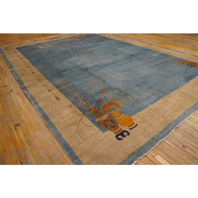 Antique Chinese Art Deco Rug with a blue background.