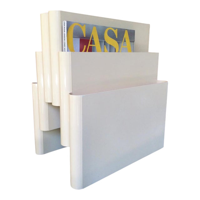 Minimalist magazine rack by Giotto Stoppino for Kartell. Italy, 1972. Made of white plastic (ABS). This is the large...