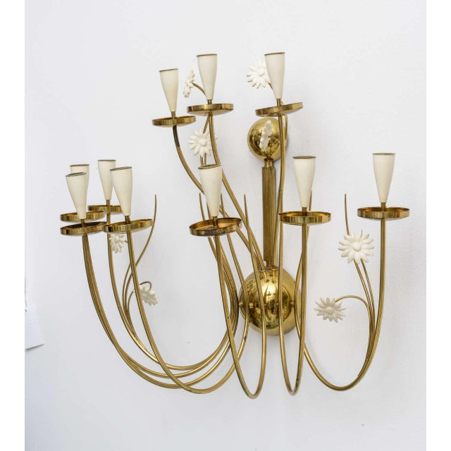Our over-sized 50's Italian candle sconce delights the eye with delicately curving brass arms and whimsical white painted...