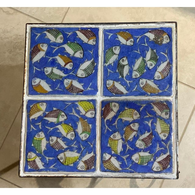 Elegant side table made of beautiful vintage four hand painted and glazed Persian tiles,of wondering fish motifs on blue...