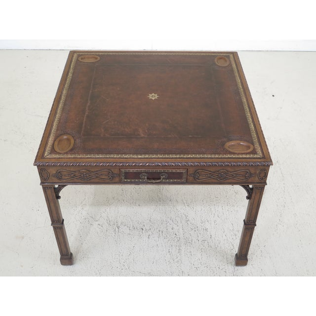 Maitland Smith chippendale style square leather top games table. Features nice carved Details, solid brass hardware and...